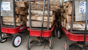 Firewood stacked in red wagons. Photo from Flickr by Steven Depolo